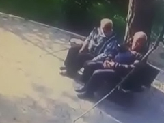 Old men open-air giving a kiss gay to gay