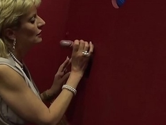 Busty British mature Foetus Sonia visits a gloryhole